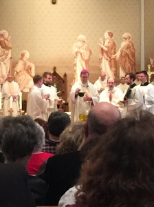 Bishop Doherty adds sacred balsam.